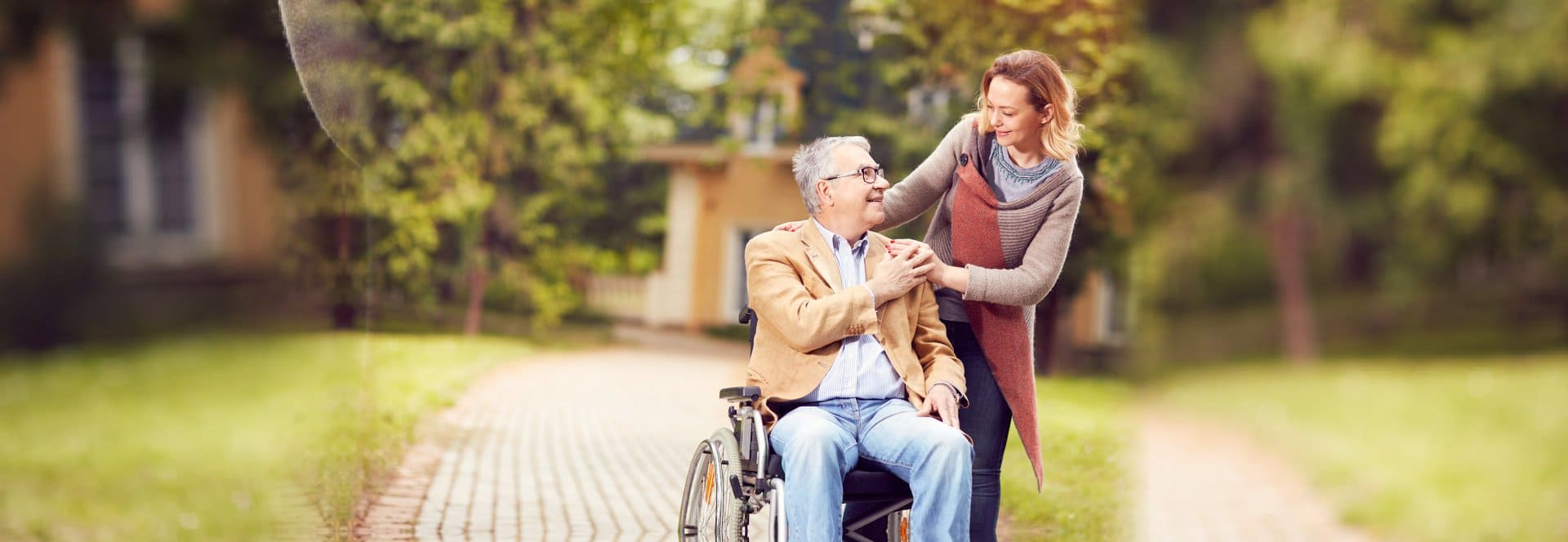 senior man in a wheelchair and caregiver