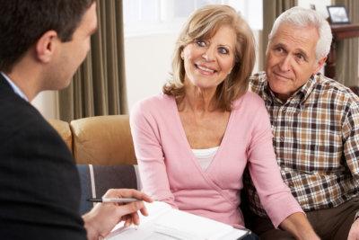 senior couple talking with advisor