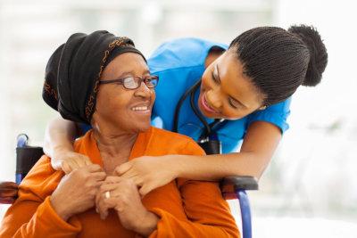 happy senior woman and friendly nurse