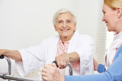 senior woman getting physical therapy