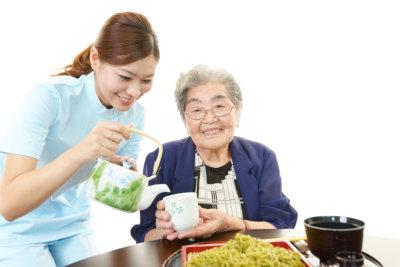 friendly nurse taking care of an elderly woman