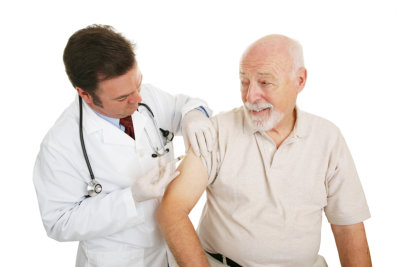 senior man getting a flu shot from his doctor
