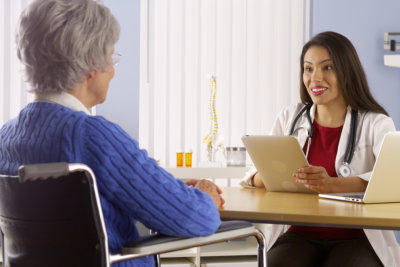 young woman and senior talking